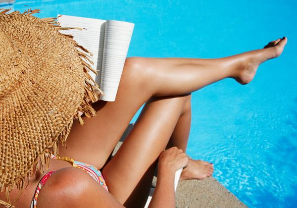 Istock 3922981 Woman Reading By Pool